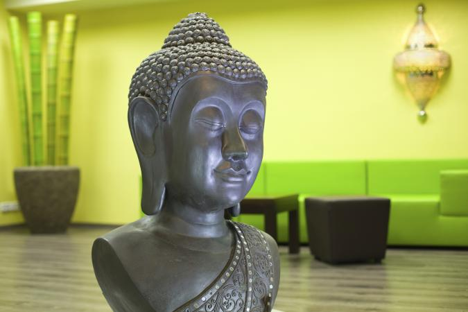 Buddha statue in yoga studio