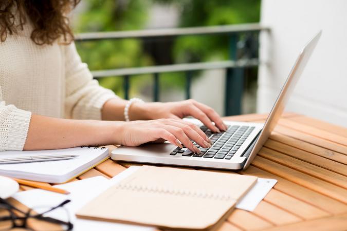 Novelist working on laptop
