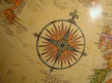 compass on a globe