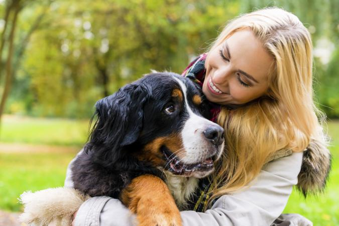 Woman embracing her dog