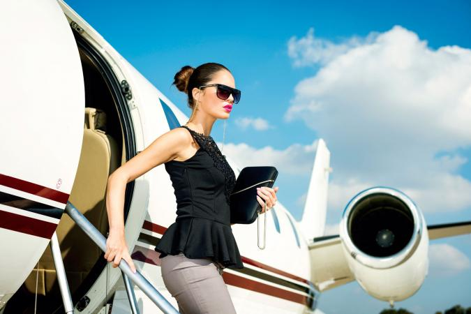 Woman exiting airplane