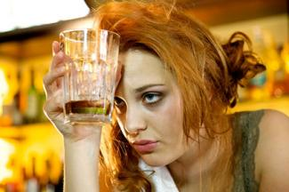 Woman having too much to drink