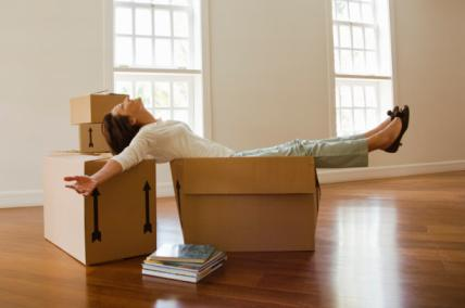 Woman reclining on moving boxes
