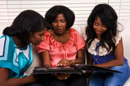 Mother and Daughters with Photo Album