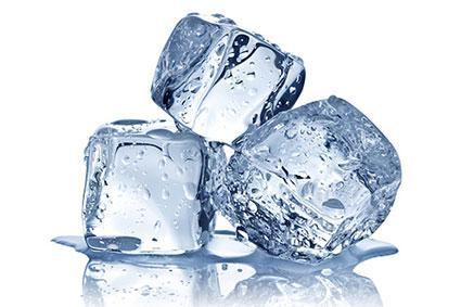 Three ice cubes melting