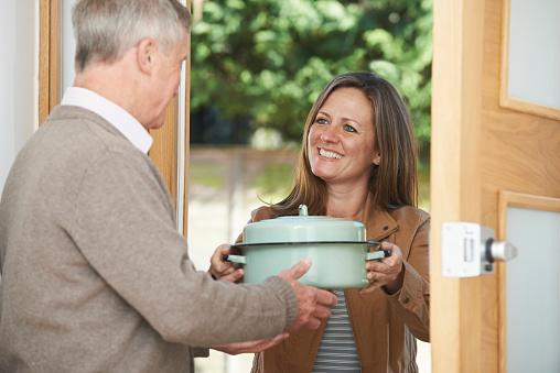Woman Bringing Meal For Neighbor