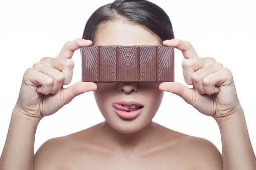 Woman holding chocolate bar