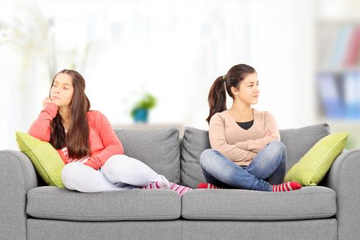 Teenage girls sitting on sofa