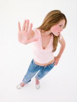 Teenage girl with hand up