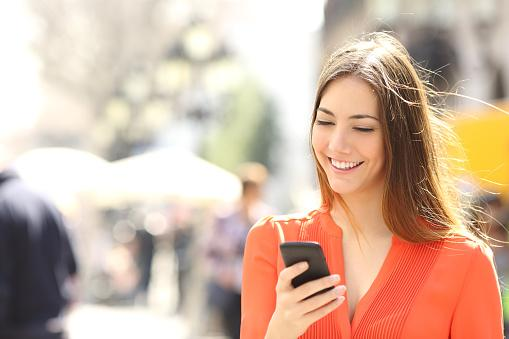 Woman texting on smart phone