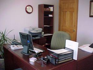 A small office desk and chair