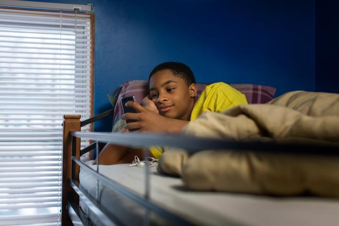 boy in loft bed