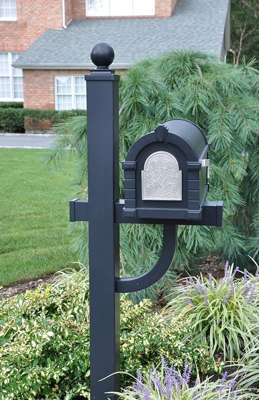 black mailbox with pine tree