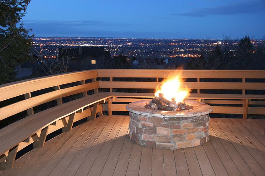 deck overlooking city with firepit