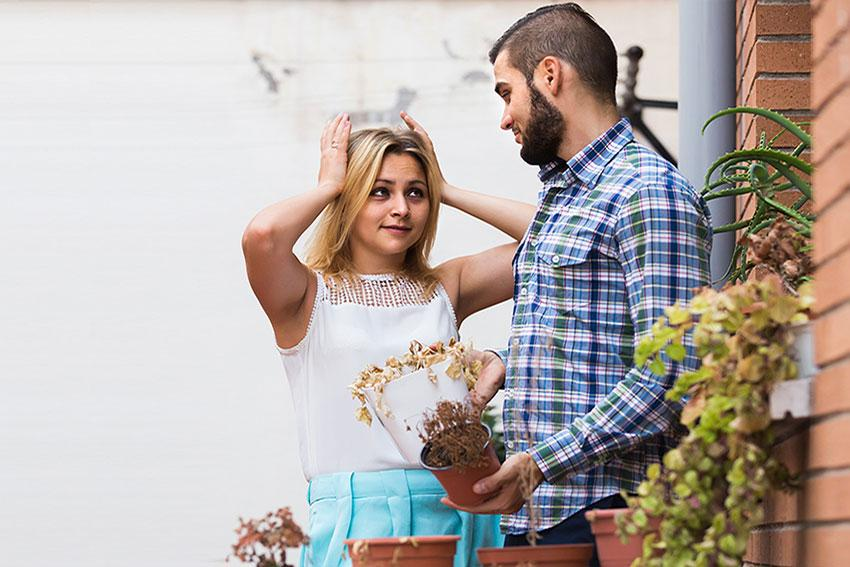 frustrated couple with plants