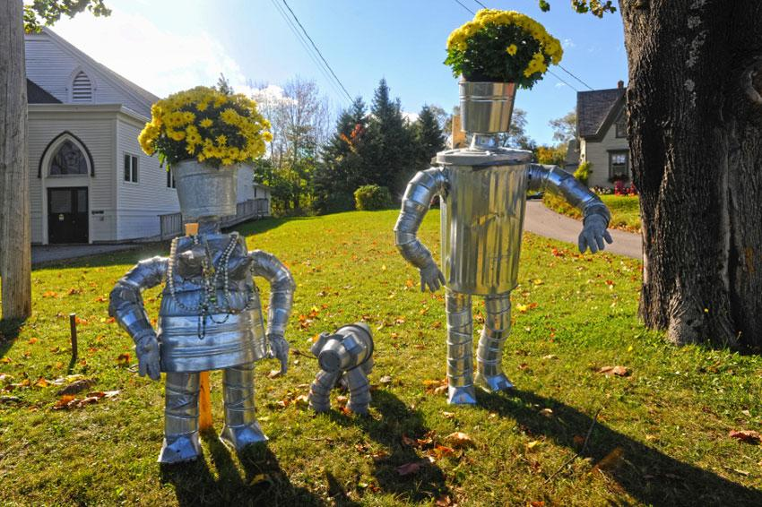 Tin people planters with bucket dog