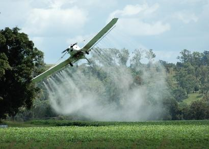 Crop dusting with pesticides.