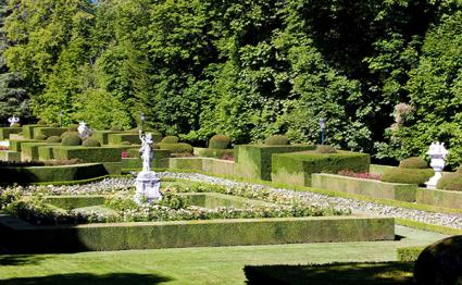Formal garden with hedges and statue