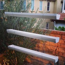 Rain gutter vertical planters