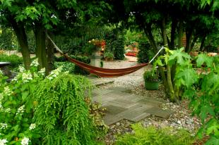 empty hammock over patio