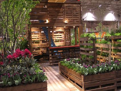 Sustainable green patio gardens for Wooden studios for gardens