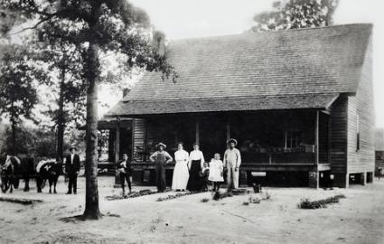 family on early homestead