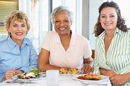 Mature women sharing a meal