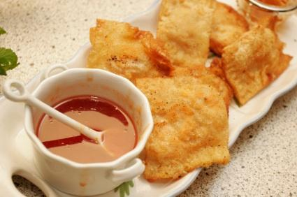 Crab cheese rangoon are delicious with a mustard dipping sauce