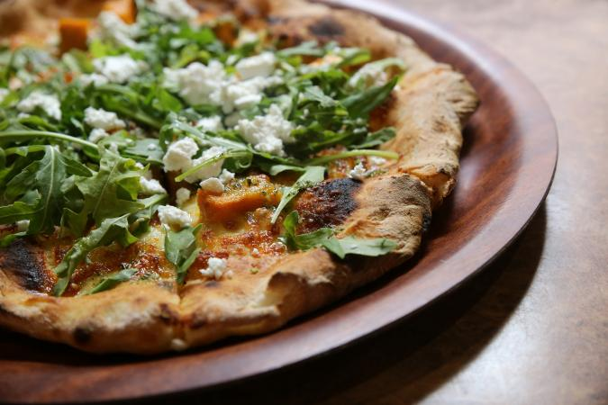 Pizza with rocket and feta
