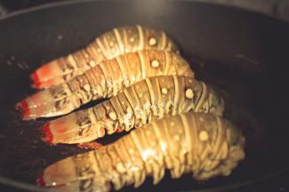 Lobster tails in pan