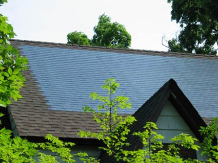 Photovoltaic Shingles Installed On Top Of Existing Roof