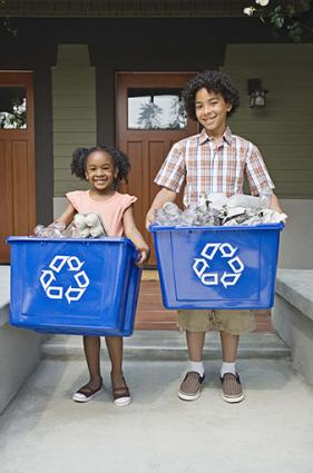 Kids with recycling bins