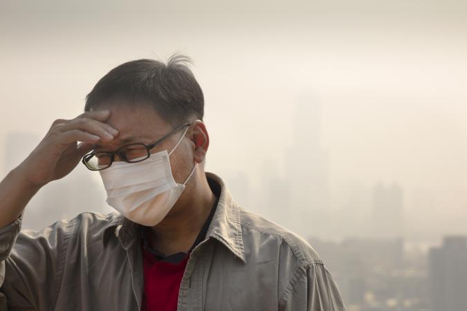 Man in mask with air pollution
