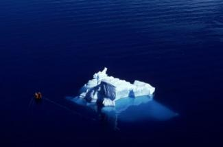 Aerial shot of boat and Iceberg in Paradise Bay, Antarctica