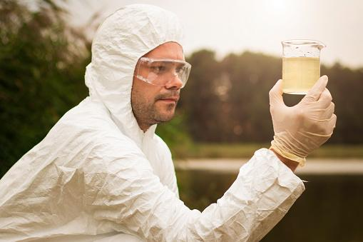 Scientist examining toxic water