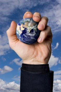 Man holding earth ball in hand
