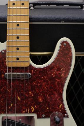 fender guitar sitting in front of amplifier
