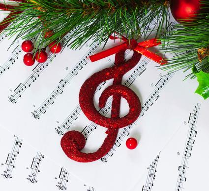 Treble clef ornament and sheet music