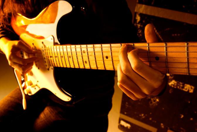 Playing a guitar chord
