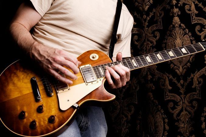 Man playing Gibson guitar