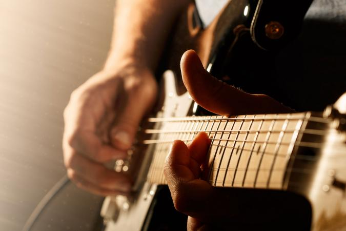 Close up of playing electric guitar