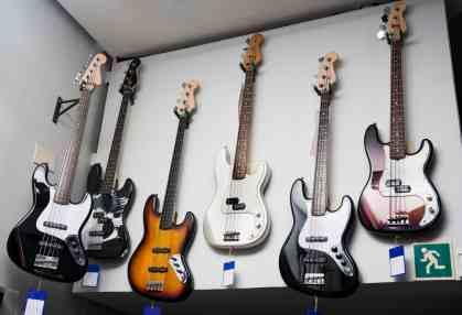 Bass guitars on shop wall