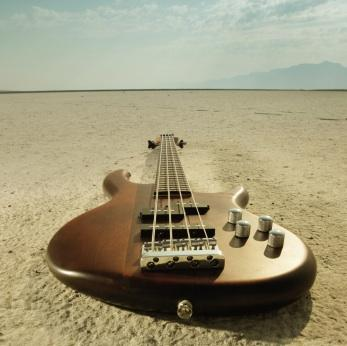Bass guitar in the desert
