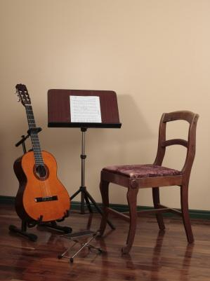 Guitar, music stand and chair