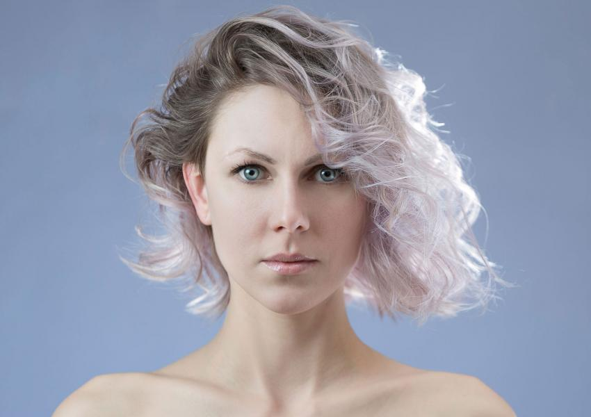 Woman with dyed ends on short curly hair