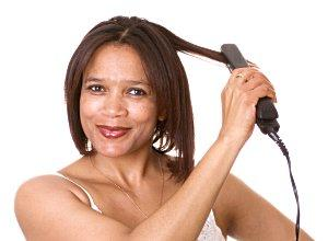 Woman straightening hair.