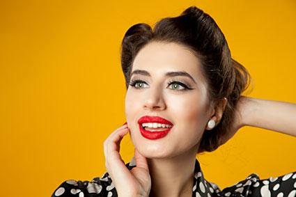 Pin up hair styles lovetoknow pin up style with victory rolls urmus Gallery