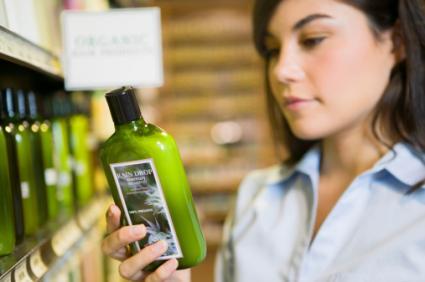 Woman reading shampoo label