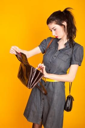 woman looking inside compartments of purse