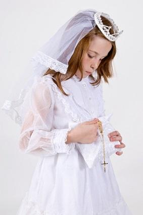 Girl with first communion purse